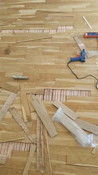slipa trägolv för hand